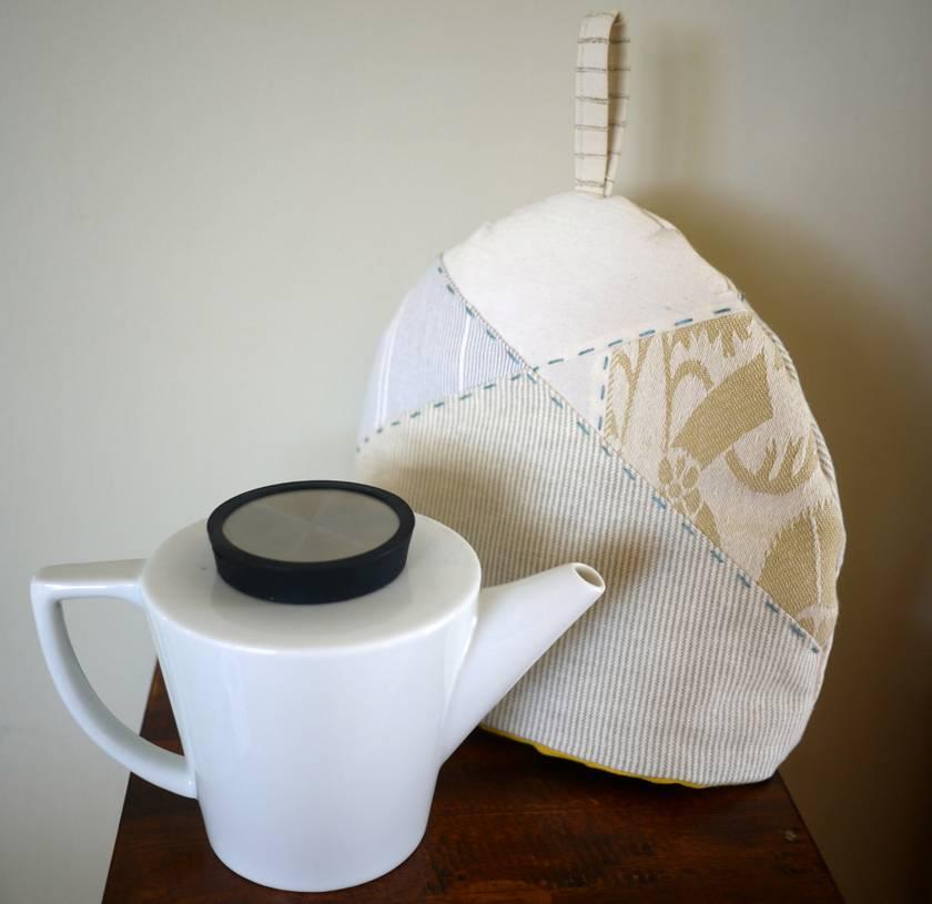 Elegant handmade tea cosy in neutral colours.
