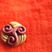 Two toned handmade button.