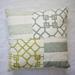 Soft greens and blues embellished cushion.