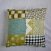 Stunning patchwork cushion in vibrant contemporary colours.