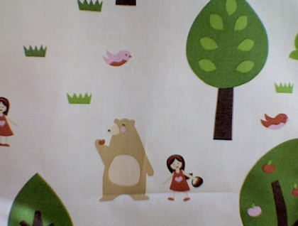 Little girl and bear in the forest