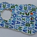 """Chenille Baby Bib """"The Very Hungry Caterpillar with Letters"""""""
