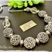 Detailed puffed silver necklace