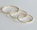 Three gold rings- 9ct yellow, rose or pink