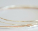 Silver and gold stacker bangles (x 4 medium size)