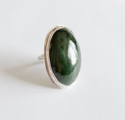 Medium sized greenstone and oxidised sterling silver oval ring