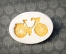 Mustard ceramic biycle brooch