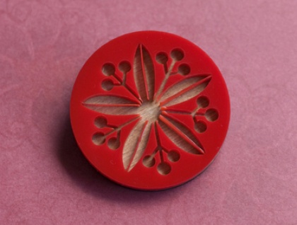 Red flower with berries brooch