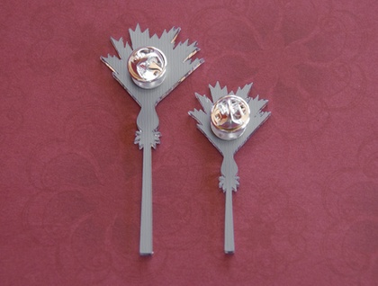 Mirror nikau brooches