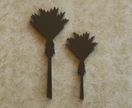 Black nikau brooches