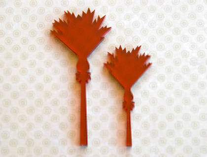 Red nikau brooches