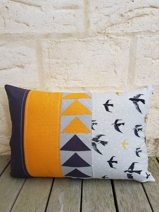 Patchwork triangle grey birds cushion