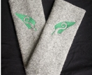 Beautiful woollen fingerless gloves -light grey with green kiwiana koru embroidery