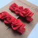 Red rose hair clips