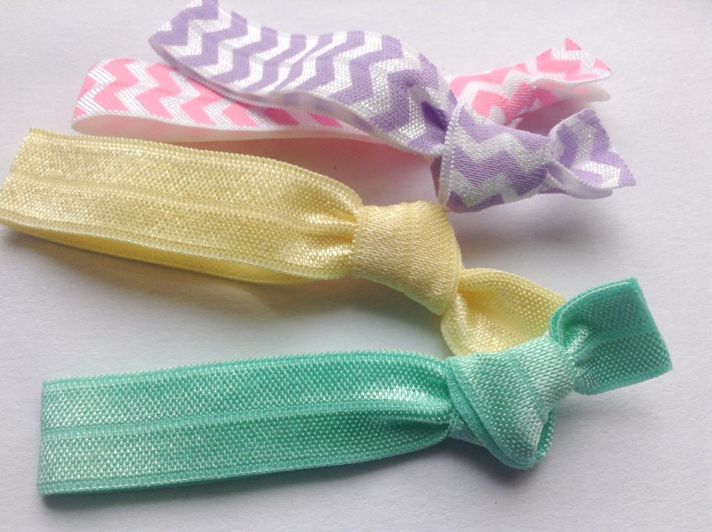pastel pink yellow and turquoise knotted hair ties felt
