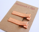 Orange and white striped hair clips