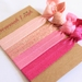 Pink shades knotted hair ties