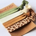 Neutral tan khaki and leopard print knotted hair ties