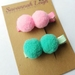 Teal and pink pom pom hair clips set of two