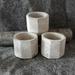 Concrete tea light candle holders.