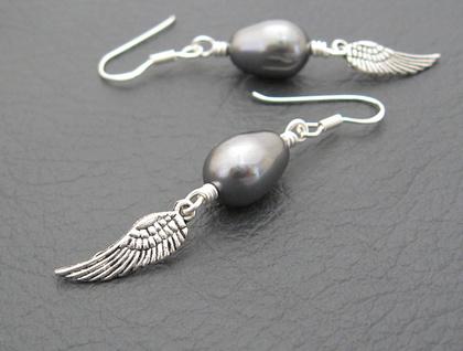 Storm-angel earrings: deep grey Swarovski pearls with angel wing charms