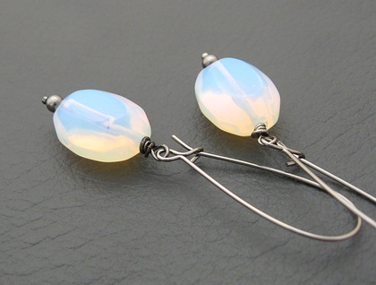 Sea Opal earrings: moon-like glass ovals on long black ear-wires