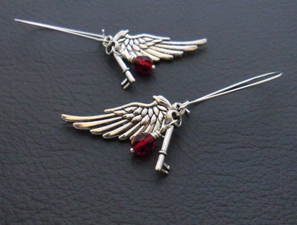Altan earrings: cluster earrings with silver angel wings, key charms, and deep red glass