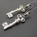 Victorian Silver Key earrings: silver-plated key charms on long, gunmetal-black earwires