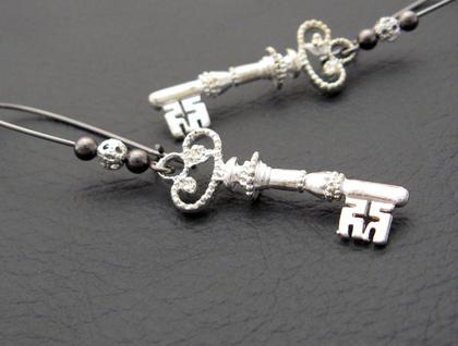 Silver Key earrings: silver key charms on gunmetal-black ear wires
