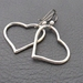 Curious Heart earrings: quirky, antiqued-silver coloured heart shapes on niobium hooks