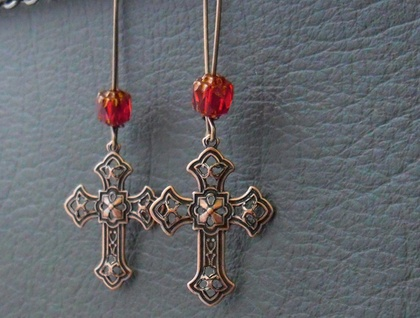 In The Scarlet Cathedral earrings: antiqued copper-plated crosses with brilliant red glass on long ear-wires