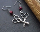 Artful Seamstress earrings: antiqued-silver coloured scissor charms with pearly, crimson glass beads