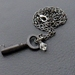 Silent Key necklace: vintage reproduction key pendant with crystal on gunmetal-black chain
