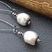 Marguerite earrings in white: Swarovski pearls on gunmetal coloured ear-wires – last pair!