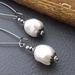 Marguerite earrings in white: Swarovski pearls on gunmetal coloured ear-wires –last pair!