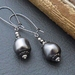 Marguerite earrings in dark grey: Swarovski pearls on gunmetal coloured ear-wires – last pair!