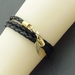 Leatheroid Triple Wrap Bracelet in gold: black imitation leather with gold-plated clasp and angel wing – last one!