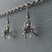 Dark Spider earrings: shiny dark-grey spider charms on gunmetal black hooks