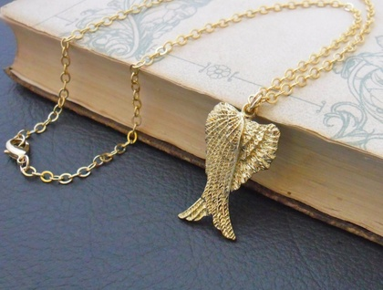 Blessed Wings necklace: folded angel-wings pendant in light gold on gold-filled chain