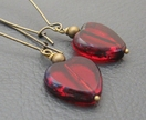 Ruby Heart earrings: deep red glass hearts with a stony edge, on long bronze-coloured ear-wires – last pair!