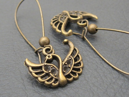 Swans In Bronze earrings: antiqued-bronze coloured swan charms on long ear-wires