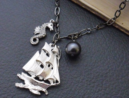 Nigh Uncatchable: a pirate-themed necklace featuring a pewter ship, antiqued-silver seahorse and black Swarovski pearl