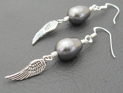 Storm-Angel earrings: deep grey Swarovski pearls with wing charms on sterling silver hooks – last pair!