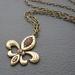 Fleur-de-Lys d'Or: antiqued golden, heraldic pendant with topaz rhinestones – one of a kind