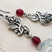 Rose Vine earrings: romantic, antiqued-silver coloured roses with deep red glass beads -- last pair!