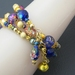Festival: a sparkling three-wrap bracelet in blues, golds, yellows, and purples – one of a kind