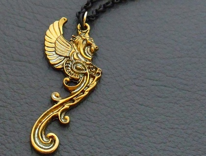 Golden Gargoyle necklace: antiqued-gold mythical beast pendant on gold and black chain – last one!