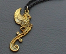 Golden Gargoyle necklace: antiqued-gold mythical beast pendant on gold and black chain