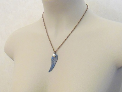 Rusty Blue Wing necklace: distressed angel-wing pendant with blue patina and cream faux pearl on copper chain