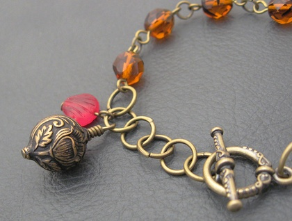 Heirloom Tulips: a vintage-inspired charm bracelet in antiqued brass and amber glass – one of a kind